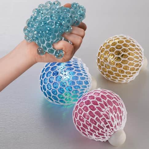 Quetschbälle-Set, 12-tlg. Glitzer, mit LED-Wechsellicht, Kunststoff, ca. 6,5 cm Durchmesser Inszeniertes Bild