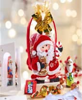 Präsenttäschchen Weihnachtsmann, gefüllt mit ca. 50g  Weihnachtspralinen Inszeniertes Bild
