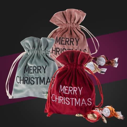 Weihnachtsbeutel aus Samt, gefüllt mit Schokolade, je ca. 50g Pralinenkugeln Inszeniertes Bild