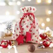Weihnachtsbeutel, gefüllt mit Schokolade Rote Sterne, ca. 60g Milchschokolade Inszeniertes Bild