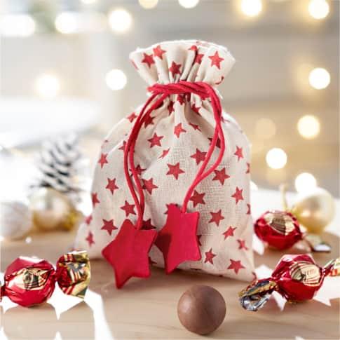 Weihnachtsbeutel, mit Füllung Rote Sterne, ca. 60g Milchschokolade Inszeniertes Bild