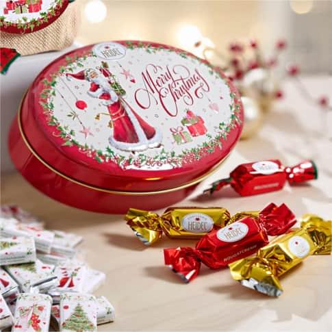 Präsentdose Weiße Weihnacht, Schokopralinen aus Vollmilchschokolade Inszeniertes Bild