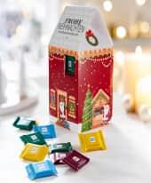 Adventskalender Weihnachtshaus, ca. 120g, Alpenmich, Mandel, Halbbitter und Knusperflakes Inszeniertes Bild