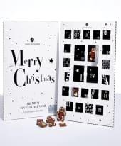 Adventskalender Black & White, 20 quadratischen Täfelchen und 4 Schoko-Lebkuchenmännchen, alkoholfrei Inszeniertes Bild