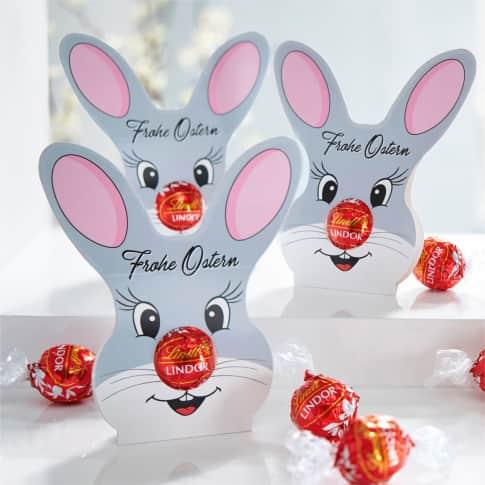 Lindor-Kugel-Set, 10-tlg. Hase, Rote Lindor Kugel aus Milchschokolade, Werbekartonage Inszeniertes Bild
