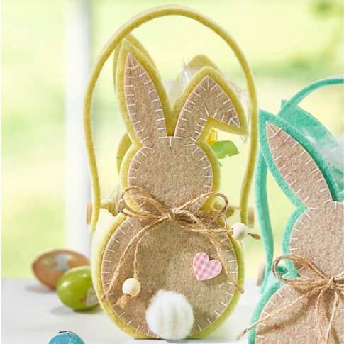 Präsenttasche, mit Füllung Hoppel, Ostersüßware, Eier aus Milchschokolade mit Haselnusscreme-Füllung Inszeniertes Bild